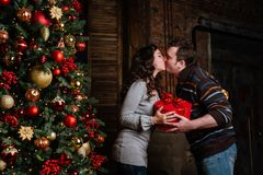 Merry Christmas. Young couple celebrating Christmas at home Stock Photos