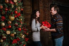 Merry Christmas. Young couple celebrating Christmas at home Royalty Free Stock Images