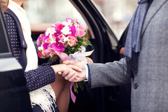The guy gives girl a flowers Stock Photos