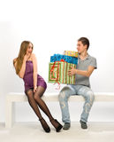 Guy gives the girl gifts Royalty Free Stock Photography