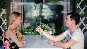 The guy gives the girl a ring. stock footage