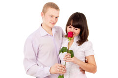 The guy gives a girl a rose, makes a proposal Royalty Free Stock Images
