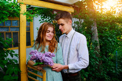 Guy gives his girlfriend a bouquet of lilacs Stock Photos