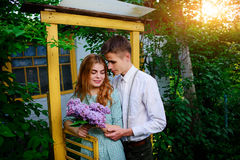 Guy gives his girlfriend a bouquet of lilacs Stock Photo