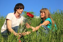 Guy Gives To Girl Bouquet Of Roses Royalty Free Stock Images