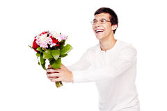 Guy giving bouquet of flowers. Young hispanic man in love wearing glasses and white long sleeve, giving bunch of flowers and happy smiling - dating concept Stock Photo