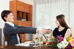 Guy giving a gift to young women Stock Images