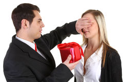 A guy giving a girl a present Royalty Free Stock Image