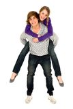 Guy giving girlfriend a piggyback ride Royalty Free Stock Image