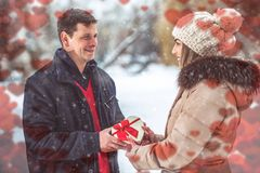 Guy giving his girlfriend valentines present stock image