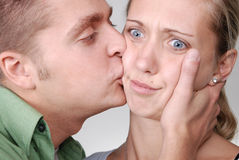 A guy giving a kiss to her girlfriend Stock Image