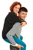Guy giving piggy back ride to woman Royalty Free Stock Image