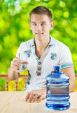 A guy with glass of water Royalty Free Stock Images