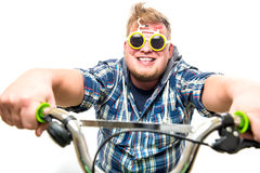 Guy with glasses in a bike Stock Photos