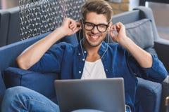 Guy in glasses feeling goosebumps Stock Images