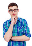 Guy in glasses with hand on chin Royalty Free Stock Images