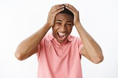 Guy going crazy feeling pressured and fed up, losing temper pressing hands to head yelling out loud displeased and. Distressed being freaked out, panicking royalty free stock images
