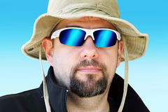 Guy going on expedition. Portrait of a man during outdoor expedition with sun hat and mirror sunglasses Stock Photography