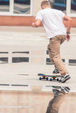 Guy is going to skateboard at skatepark outdoor Stock Images