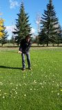 Guy golfing. Guy swinging golf club on course Royalty Free Stock Photo