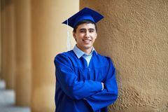 Guy in graduation gown Stock Photography