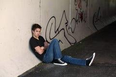 Guy by graffitti stock image