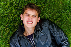 Guy in grass Stock Photography