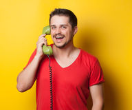 Guy with green retro dial phone Stock Images