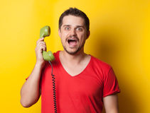 Guy with green retro dial phone Royalty Free Stock Image