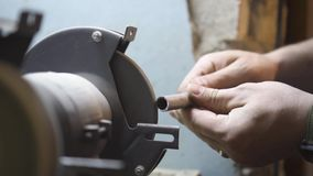 The guy grinds metal on the machine. Guy grinds metal on the machine stock video footage