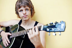Guy with a guitar. Royalty Free Stock Images