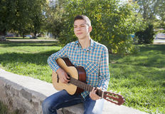 Guy with a guitar Stock Photography