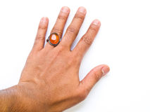 A guy hand with amber  ring on his finger isolated on white back Stock Images