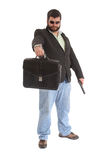 Guy handcuffed to a leather case Royalty Free Stock Image