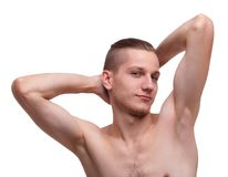 A guy with a naked torso posing on a white isolated background. Guy handsome and with a good hairstyle with a bare torso posing on a white isolated background Royalty Free Stock Image