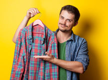 Guy with hanger and shirt Stock Photography