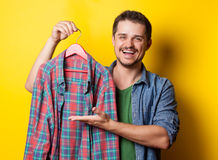 Guy with hanger and shirt Stock Photos