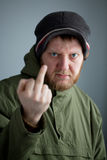 The guy in the hat. And jacket shows rude gesture Stock Photography