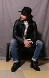 Guy in a hat and leather jacket stock photos