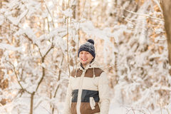 The guy have a rest in the winter woods. Royalty Free Stock Images