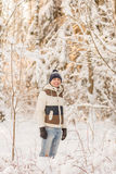 The guy have a rest in the winter woods. Royalty Free Stock Photography