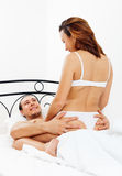 Guy having sex with girl in bed Stock Image