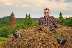 Guy on hay Stock Image