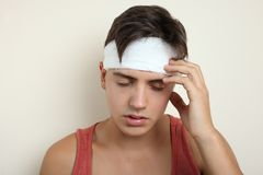 A guy with a head injury. On a neutral background. Concept first medical aid royalty free stock photography