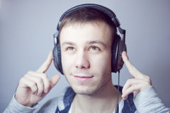 Guy in headphones. Listens to music Royalty Free Stock Photo