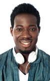 Guy with headphones around his neck Royalty Free Stock Photo