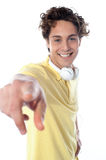 Guy with headphones pointing at you Royalty Free Stock Photo