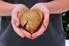 A guy with a heart in his hands Royalty Free Stock Photos
