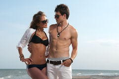 Guy and his girlfriend. Are on the beach Stock Images