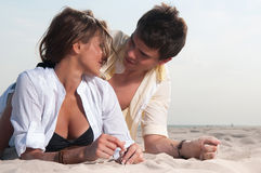 Guy and his girlfriend. Are on the beach royalty free stock photos